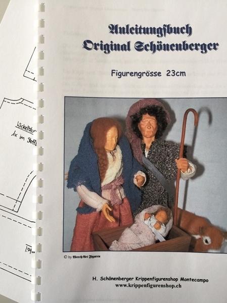 Bild von Anleitungsbuch und Schnittmuster Grösse 23cm